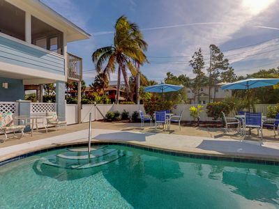 Photo for Bay-facing condo w/amazing view, shared pool & beach across street