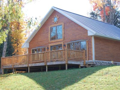 Luxury Log Home nestled on 6 private acres overlooking the Manistique River