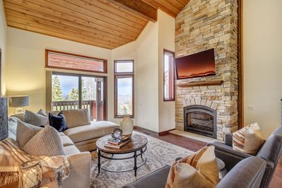 Family Room with mountain views, gas fireplace and flatscreen TV.