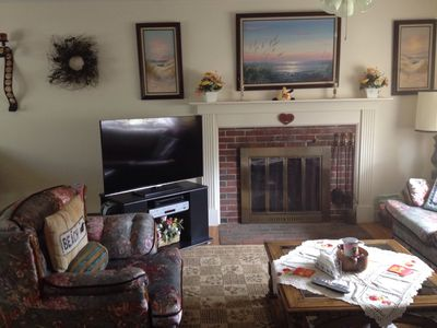 Living room with HD TV and gas fireplace