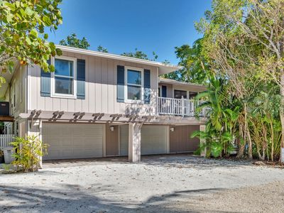 Photo for Beach Paradise fully renovated home 60 seconds to the Gulf right out the front door!  APRIL SAVINGS!