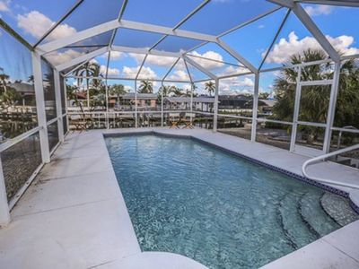 Photo for Welcome to 5211 Avenida Pescadora.   This sprawling four bedroom three full bathroom, waterfront home has a beautiful in-ground heated pool and is just a one minute walk from the white sugar sand beaches of Fort Myers Beach.