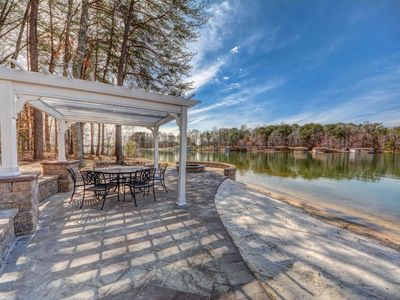 Photo for NEW LISTING! Spacious lakefront home with private shoreline, dock, kayaks & more