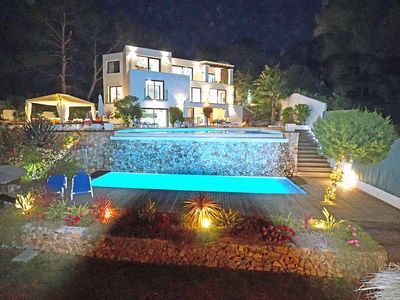 Photo for Spectacular 180 DEGREE VIEWS SEA/SUNSET 2 SWIMMING POOLS, JACUZZI, GYM ,TENNIS