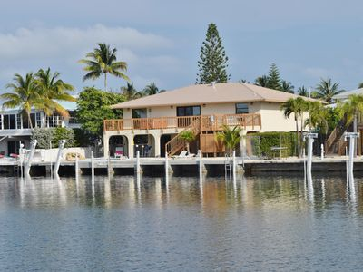 Beautiful ocean front home with deep water dock for easy boating.
