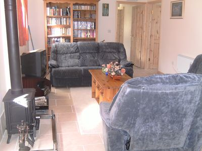 The sitting room including the woodburner