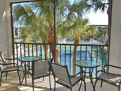 Photo for Island-style condo in deluxe riverfront community w/ pools & spas