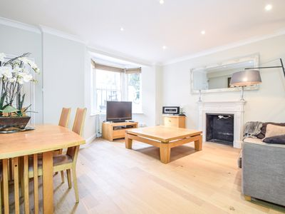 Photo for Charming large and cosy garden apartment in Earls Court, Chelsea
