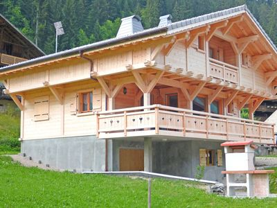 Photo for Charming wooden chalet just 350 m from the ski lifts
