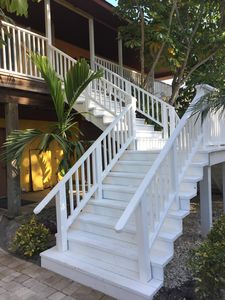 This is an upstairs unit accessed via a wide staircase.