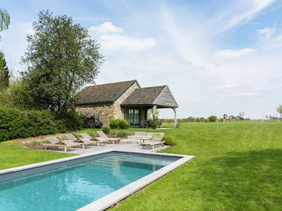 Photo for Family cottage with heated pool and infrared sauna.