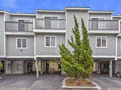 Photo for OCEAN FRONT - FREE DAILY ACTIVITIES!!  Beautiful Four bedroom town home with 2.5 baths situated behind the dunes approximately 300 feet from the beach.