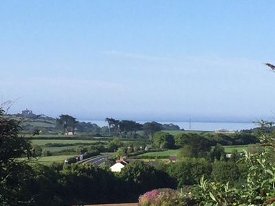 View on a sunny day from the master bedroom across to St Michaels Mount & the se