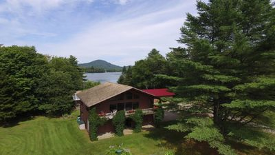 Photo for Beautiful lakefront home, 20 acre private lot. Close to Stowe and Jay Peak