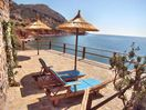 OLONDI:private sunbathing terrace left of the cottge directly upon shore 3 snbds