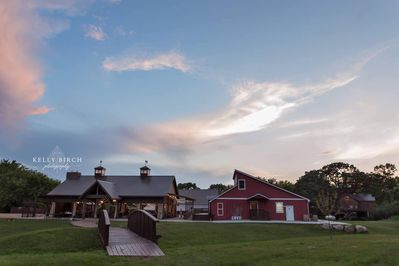 The Corn Crib Cottage is the Center RED Building The TreeHouse is to the right.