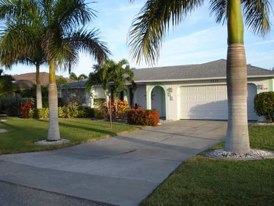 Photo for Tropical Paradise Living With Central Location,  Heated Private Pool