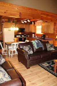 New leather sofa & loveseat, seating for 6 in dining  & fully stocked kitchen.
