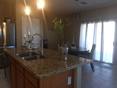 Photo for Centrally located spacious home  venues, sports and airport Sleeps 9