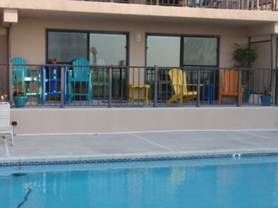 Fun colorful deck furniture for poolside lounging