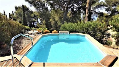 Photo for Provencal spirit holiday home, sea view and pool 300 m from the beach