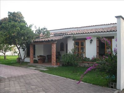 Photo for 'Colima' Charming Bungalow with Pool & Garden Patio