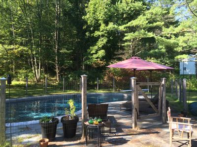 The pool & stone patio in the backyard - open from Labor Day thru mid-September