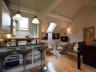 Relax in the large open-plan lounge/kitchen/diner with additional seating