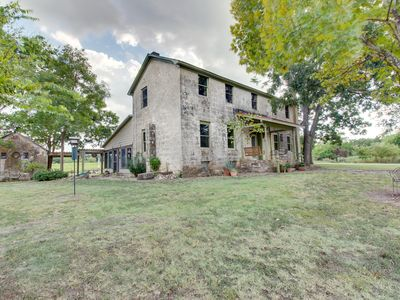 Photo for Historic 1890s limestone farmhouse on five acres w/hot tub - dogs OK!