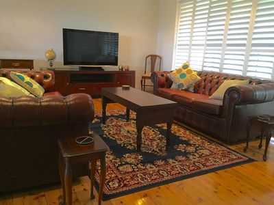 The comfortable lounge with Cherstfields and a large TV, DVD player Aand stereo.