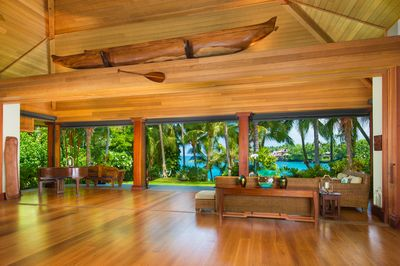 The Great Room, with soaring ceilings, intimate seating areas, and a Grand Lanai