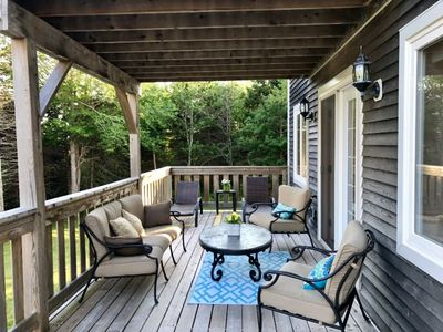 Back of deck. Loungers to enjoy full sun all day. Covered deck for shade with comfy sofa set.