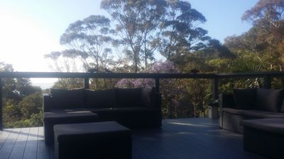 Large outdoor area with scenic bush and ocean outlook