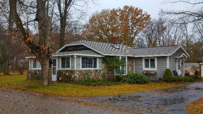 Photo for Cute Alden Stone Cottage walk to TORCH LAKE