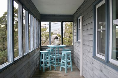 Have your morning coffee or evening cocktail on the screened in porch