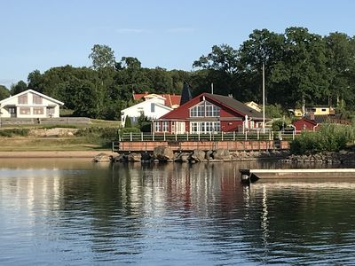 Photo for Luxury house on Lake Bolmen, sandy beach with own boat dock and heated pool, fishing