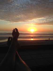 """Relaxing on our balcony saying """"PINCH ME!"""" when I'm soaking in GORGEOUS sunsets."""