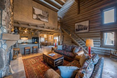 Comfy leather sofas, historical artworks of the Park City mining community, kitchen and bar with separate dining area.