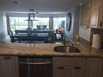 Kitchen, dining and family overlooking patio and Bay!