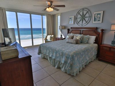 Master bedroom on the water with balcony access.