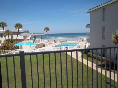 Glass doors open, sitting on the master bed overlooking our pool and oceanfront!