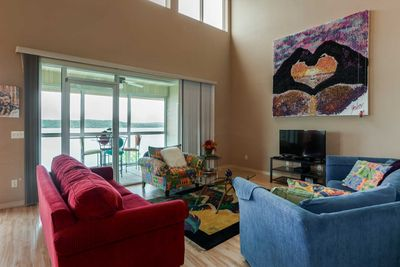 Windows abound in this beautiful living area.