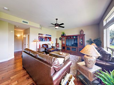 Living Room - Tucked on a quiet cul-de-sac in the desirable and gated Las Sendas community, this home is outfitted with high-end furnishings and appliances.