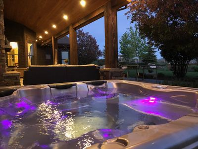 The exterior terrace offers a jaccuzzi, fireplace, ping pong, and crazy views.