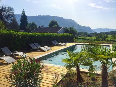 Garage behind the garden and view of the Grand   Colombier from the pool