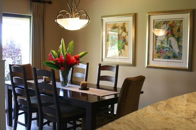Separate full dining area for 6-8 persons or bar seating for 4