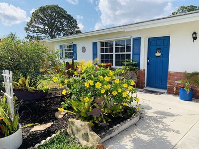 Photo for Eclectic garden home near beaches and historic downtown