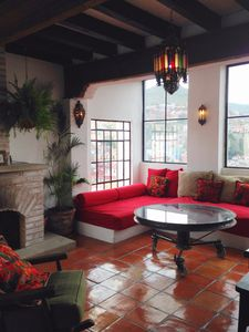 Living room with large windows to views and fireplace