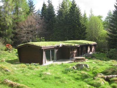 Photo for 3-bedroom log house set in woodland in the heart of Highland Perthshire