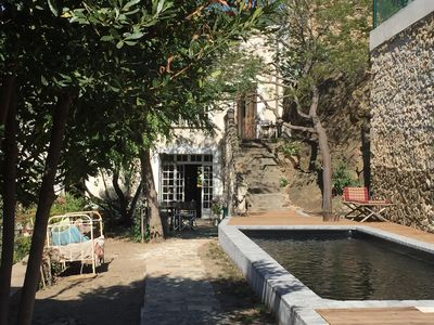 Photo for Gite of charm 93 m2 with swimming pool in house winegrower in the center of the village.